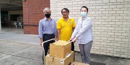 A representative from FCD delivers hundreds of face masks and alcohol gels to help prevent Coronavirus (COVID-19) for on-site APCD training participants. Representatives from APCD, Ms. Nongluck Kisorawong, Administrative Manager and Mr. Somchai Rungsilp, Community Development Manager receiving the donations.