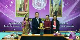 Mrs. Ubol Thongsalubluan, Provincial Social Development and Human Security Officer; Ms. Onanong Kumhang, Director of Center for Empowerment and Vocational Development for Persons with Disabilities in Nakhon Si Thammarat Province; and Mrs. Sarudda Promma, Head of Nakhon Sri Thammarat Shelter for Children, and their families presented Mr. Piroon Laismit, APCD Executive Director, with a token of appreciation.